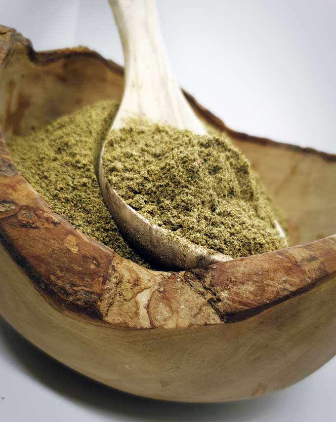 green hemp protein powder wooden bowl and spoon